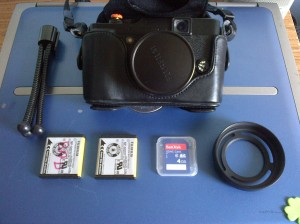 Fuji X-10, Lens Hood, Mini Tripod, 2 x NP-50 Batteries and a Sandisk 4GB SD Card